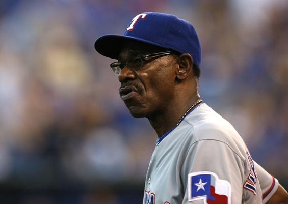 Ron Washington se separó del cargo de dirigente de Texas.